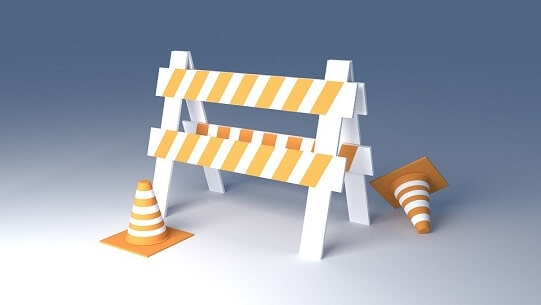 road block sign and cones